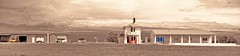 WE ARE THE MEN FROM TEXACO....WE MOVE FROM MAINE TO MEXICO (Irene2727) Tags: road blue panorama orange yellow sepia buildings landscape route66 pano structures gasstation scape selectivecolor vechiles sighposts