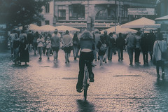Taking her own way (kimblomqvist) Tags: streetphotography street city cityscape urban urbanlife citylife bike bicycle crowd people square cophenhagen woman bicyclist shadow old oldtime canon canonphotography blackandwhite bnw bw bicecleta mujer femme ciudad calle rue ville travel