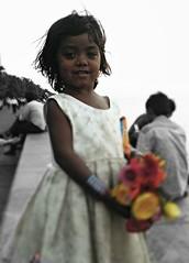 IMG_20131227_114855 (sijo09) Tags: siddhartha bose si jo photography smile girl mumbai marine drive siddharthabose sijophotography marinedrivemumbaiindia flowerseller girlchild innocent
