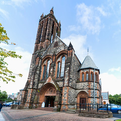 Large Panorama Falling Crescent Church Architecture Belfast North Ireland (HunterBliss) Tags: abstract architecture beautiful belfast blue brick building catholic church city clouds construction contrast crescent crooked culture entrance europe european exterior falling famous high historic historical history illusion ireland irish landmark monument north optical outdoors outside protestant religion resolution sky slanted stone street tourism tourist travel weather windows