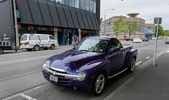 Purple Machine (Jocey K) Tags: newzealand christchurch architecture building cbd road street trees sky clouds cars van rebuild victoriast