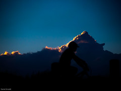 Cyclist against a cloud (Daniel Arnaldi) Tags: australasia australia landscapephotography newsouthwales oceania silhouette soldierspoint bicycle bicycling bike bluesky clearsky clouds cycling cyclist outdoors sky sunset sunny danielarnaldiphotographer