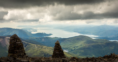 Across the Cairns (Daniel C P M) Tags: lake water sea scotland stone ben nevis mountain hill blue sky clouds green grass tress trees moody dramatic wow dark shadow pebbles landscape landscapes nikon d7100 nikond7100 nikkor outdoor outside