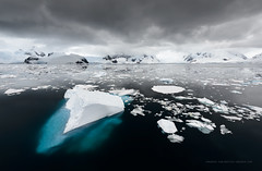 What Lies Beneath (Marsel van Oosten) Tags: squiver marselvanoosten antarctica polar cruise ocean sea water cold dark black brooding gloomy weather sky clouds icebergs ice snow surface deep danger landscape phototour workshop grey remote wild wilderness titanic