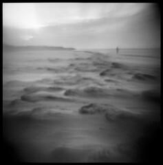 The Ocean Desert (LowerDarnley) Tags: agfaisoly modifiedcamera flippedlens reversedlens transplantedlens pei princeedwardisland beach ocean sand atlanticcanada maritimes figure walkng