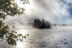 Foggy on the river in the city (beyondhue) Tags: ottawa river quebec ontario fog morning fall autumn bate island landscape water shore banks shoreline sun reflection beyondhue canada season bright mist cloud blue sky tree leaves branch frame