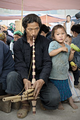 Man playing a musical instrument (mouth organ called khene) in Mo Vc market - H Giang Province - Vietnam (PascalBo) Tags: nikon d300 asia asie southeastasia asiedusudest vietnam vitnam vitnam vietnamese hgiang hagiang movc meovac market march people man homme hilltribe ethnicgroup ethnie ethnic ethnicity minority indigenous outdoor outdoors musique music kid child girl fille enfant pascalboegli