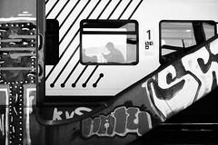 untitled (wolcottsworld) Tags: scene train monochrome bw em1 grain flickr mft olympus deutschland m43 cologne commuter streetphotography germany phone mono candid flickriver graffiti omd pro