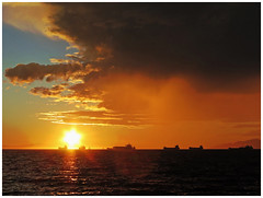 Sunset between the freighters (HereInVancouver) Tags: sunset clouds sky ocean pacific englishbay freighters ships boats water canong16 vancouverswestend vancouver bc canada sunsetlight