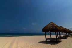 Playa del Secreto, Mayan Riviera, Mexico, 2013 (tylermielnichuk) Tags: ocean longexposure blue motion blur beach water night canon stars mexico movement smooth carribean cabana 7d silky mayanriviera playasecreto tokina1116mmf28