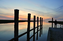 Infinite reflection (powerfocusfotografie) Tags: light sunset sea sky haven water colors backlight clouds waddenzee reflections contraluz mirror evening coast mood colours harbour spiegel perspective silhouettes noordzee symmetry northsea poles henk reflejos waddensea noordpolderzijl weerspiegelingen nikond90 powerfocusfotografie mygearandme
