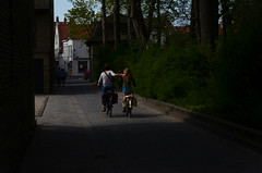 Lean on me when you're not strong (Nams82) Tags: family bike bicycle digital 50mm nikon belgium path brugge streetphotography bruges nikkor temptations fiets 8000 f18d d5100