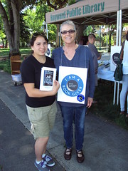 World Book Night Volunteer Group Book Giver Cheryl Ramos with Book Recipient - May 4, 2013 - Hayward, California - 1553 (Hayward Public Library) Tags: california reading libraries books terrypratchett neilgaiman literacy goodomens cityofhayward 94541 haywardpubliclibrary worldbooknight2013