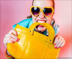 Merry young woman with yellow bag (Dmitry Mordolff) Tags: girls portrait people woman cute beautiful smile face sunglasses smiling fashion closeup laughing fun person one model glamour women funny looking view joy happiness human blond attractive only casual females emotional cheerful adults carefree 20s caucasian lifestyles 2025 ecstatic positivity expressing