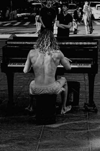 Athletic naked piano player