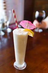 Pina colada with straw and umbrella (Semmick Photo) Tags: evening fruit nobody pink tropical umbrella wood alcohol alcoholic beverage blended brown citrus classic closeup club cocktail coconut coconutcream coconutmilk cold colddrink crushedice drink fresh glass ice juice lemon liquor milk mixed mixology one pinacolada pineapplejuice refreshment restaurant rum served setting shaken straw sweetcocktail table tallglass vintage wooden yellow