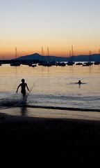 (lewispedervel) Tags: shadows kids boy running playing contrast hills boats splashing orange blue sky clean dark