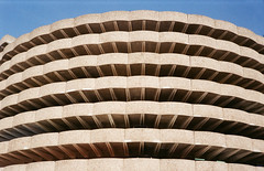 I wanna eat the whole cake #2 (joanna.kf) Tags: concrete building parking lyon architecture analogue canonet canonetql19 sky lookingup bluesky noclouds abstract minimalistic concretebuilding