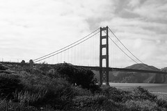 proximity (edwardpalmquist) Tags: sanfrancisco california landscape architecture goldengate bridge mountain nature ocean sky clouds plant blackandwhite monochrome outdoors travel