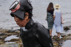 Past and Present (andrew.cantarutti) Tags: jeju korea southkorea travel haenyo women woman diver diving ocean shore coast sea water old young outdoor goggles rubber wetsuit asia culture contrast fishing freediver freediving