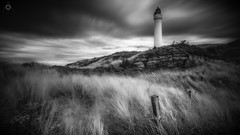 Sentinel (Augmented Reality Images (Getty Contributor)) Tags: bigstopper blackandwhite canon clouds coastline covesea fence grass landscape leefilters lighthouse lossiemouth morayshire rocks scotland