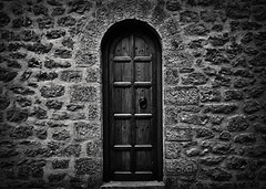 Wonder what's behind it (deppy_kar) Tags: blackwhite blackandwhite black white door olddoor old architecture wood wooden stone doorway wall meteora church monastery dark nikon nikond5200 d5200 dslr nikkor