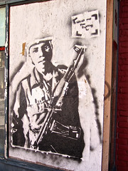 Fighting, Troy, NY (Robby Virus) Tags: troy newyork state ny stencil street art automatic semiautomatic weapon gun war fight fighting for what