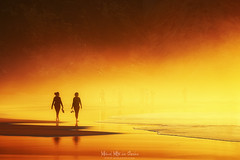 Paseo en la playa (Mimadeo) Tags: woman women couple person two people beach sunset walking sea coast vacation walk silhouette sand sunrise summer shore together mist misty haze hazy fog foggy water warm
