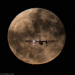 FLyMeToTheMoon (Tim McManus) Tags: lax airplane landing moon fullmoon hunters glide path approach silhouette trubo prop propeller gear