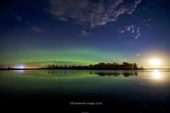 Reflecting at night (John Andersen (JPAndersen images)) Tags: borderfx aurora irricana pond meteor reflections moonrise