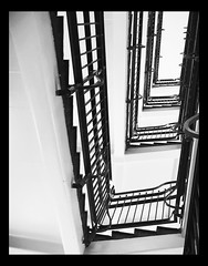 Staircase in Glasgow Royal Infirmary Hospital. (frankhimself) Tags: 5floors 4levels levels floors size shapes mixture sepia monotone blackandwhite bw wroughtiron bannisters railings architecture lighting lit oblong stairway staircase stairs scotland glasgowroyalinfirmaryhospital
