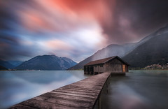 Boathouse (Simon.Ru) Tags: sunset achensee austria boathouse lake water clouds sun silky longexposure tripod ndfilter wood red mirror rain tyrol pertisau outdoor nature reflection horizon beautiful canon sigma 70d