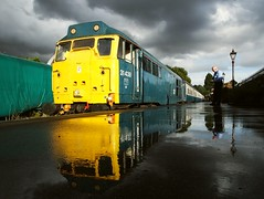 Yellow Submarine - 31438 at Ongar, reflecting in the rain soaked platform, after a heavy shower. Epping Ongar Railway. 16 10 2016 (pnb511) Tags: eppingongarrailway trains heritage railway locomotive loco rail ongar station diesel reflection wet