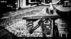 BROOKS (Mister G.C.) Tags: blackandwhite bw image streetshot streetphotography photograph monochrome urban town city bike bicycle saddle closeup oldfashioned vintage retro object gritty ricoh ricohgr pointshoot mistergc schwarzweiss strassenfotografie niedersachsen lowersaxony deutschland europe