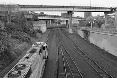 Union Pacific (FlneurFloyd) Tags: bridge freeway train tracks unionpacific pdx oregon portland fujifilm fuji x100t