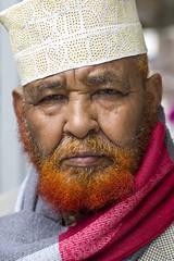 Stranger #053 (Zo0Bear) Tags: red portrait orange man color colour male face hat canon beard photography 50mm muslim leeds stranger portraiture 100 colourful humans hol somalian of 100strangers