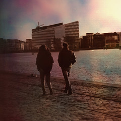 Walking (PAOLA SUAREZ DURAN ::MY VIEW::) Tags: sunset cold color texture water canon buildings copenhagen walking denmark 50mm harbor spring movement couple rails kbenhavn manandwoman brickfloor islandbrygge 365project paolasurezdurn