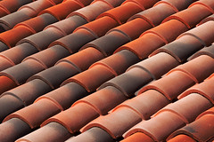 pattern of diagonal roof tiles (Mimadeo) Tags: roof red house abstract detail texture home vertical closeup architecture tile construction pattern exterior background row line diagonal cover material protection striped textured repeat waterproof roofing tiled weatherproof