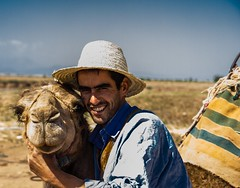 One man & his Camel (Shelbypoppit) Tags: life africa street city light portrait mountains landscape photography interesting cityscape market muslim spice working culture mosque morroco camel busy maroc atlas marrakech souk medina marrakesh souks smelly marroc riad low cinamon peaple kniza light north africa