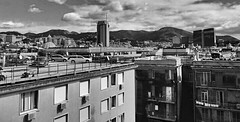 """""""Parking overhanging"""" (giannipaoloziliani) Tags: city sky blackandwhite italy cars buildings landscape downtown parking horizon perspective citylife streetphotography monochromatic palaces urbanlife overhanging urbanstreet giannipaoloziliani"""