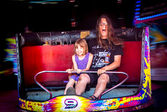 Day 235, 2016, a photo a day. (lizzieisdizzy) Tags: outside outdoors fair fairground rides waltzer music noise carriages round cicular seats bar safety fatheranddaughter happiness enjoy enjoyment laughing scream frightening swinging undulating spinning faster lights neon
