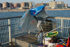 Homeless (dtanist) Tags: nyc newyork newyorkcity new york city sony a7 canon fd 50mm brooklyn coney island boardwalk homeless spot man parasol umbrella steeplechase pier shopping cart