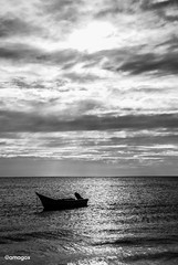 Drifted by the sun (Amagox) Tags: blackandwhite bw black white blanco negro blancoynegro grey gris sony sonyalpha alpha sigma sigmalens lente sky cielo cloud nube clouded nublado sol sun light luz mar oceano ocean sea beach playa lancha boat adrift alone solo soledad lonely one