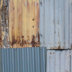 Vancouver Abstract (No Great Hurry) Tags: thenakedabstract texture abstract robinmauricebarr vancouver corrugated iron urbanabstract granvilleisland canada wall yellow rust rusted grey 50mm 500mm prime canon lines 2016 september september2016 urban line ligne linear nogreathurry bsquare robin ngh abstrait
