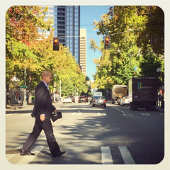 pedestrian (Richard Walker - Seattle Photographer) Tags: seattle wa usa downtown pedestrian walk trees street road intersection instagram richardwalker iphone crosswalk redlight stop