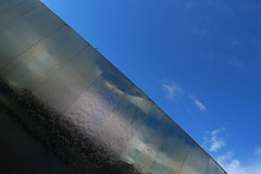 Cutting Edge (Nomis.) Tags: blue sky sculpture reflection art water station train lumix mirror stainlesssteel steel yorkshire railway polish panasonic reflect edge cutting stainless cuttingedge southyorkshire lx3