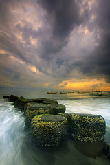 Dark Cloud Hang Over (Pandu Adnyana (thanks for 100K views)) Tags: bali cloud sunrise indonesia long exposure wave breaker sanur flickraward flickraward5 flickrawardgallery