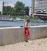 James Morrison jogging topless in the blazing sun along the riverbank Rheinufer. Cologne, Germany