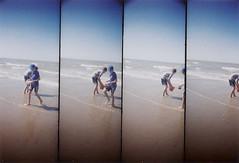 buckets of sea water (-justk-) Tags: sea beach kids bucket lomography supersampler blankenberge 35mmfilm lomographyfinecolor35mmfilm