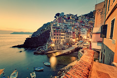 Fell in love with Riomaggiore (Allard One) Tags: longexposure nightphotography sunset italy water vintage boats coast spring nikon rocks village nightshot liguria scenic panoramic cliffs retro le vista coastline cinqueterre geography mei fishingboats commune lente region eclectic italie harsh mediterraneansea bold riomaggiore vessels 2012 extremewideangle laspezia yellowed tiamo 14mm pittoresque famousplace locallandmark nationallandmark internationallandmark touristdestination 5xp nikcolorefexpro towerhouses d700 enfuse coastalvillage nikond700 gulfofgenoa nikkor1424mmf28 mediterraneancountry nikonfx allardone allard1 duohardstrak rimazuu totallyradactionmixii fullframepower allardschagercom fellinlovewithriomaggiore